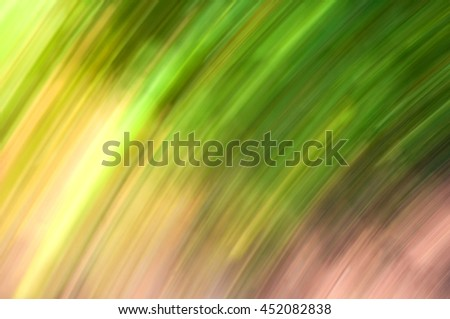 Abstract art for background use. An image of a forest processed with a motion blur effect. The color tone is green. - stock photo