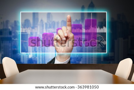 Abstract art image of businessman's hand presentation with touch screen on mirror of building at conferrence meeting room - stock photo