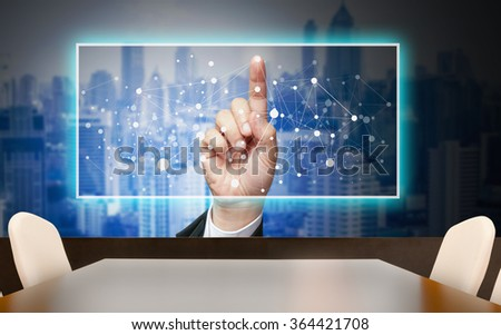 Abstract art image of businessman's hand presentation with touch screen on mirror of building at conferrence meeting room. - stock photo