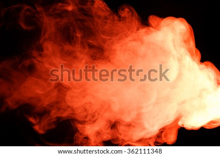 Abstract art. Red smoke hookah on a black background. Inhalation. The steam generator. The concept of poison gas. Gas. - stock photo