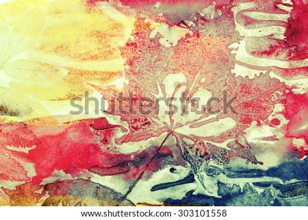 Abstract artistic watercolor background with autumn leaf prints on paper