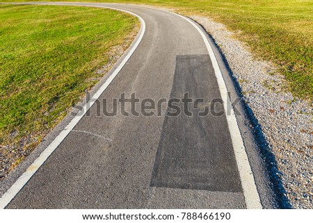 Abstract asphalt road in the park (bicycle lane)
