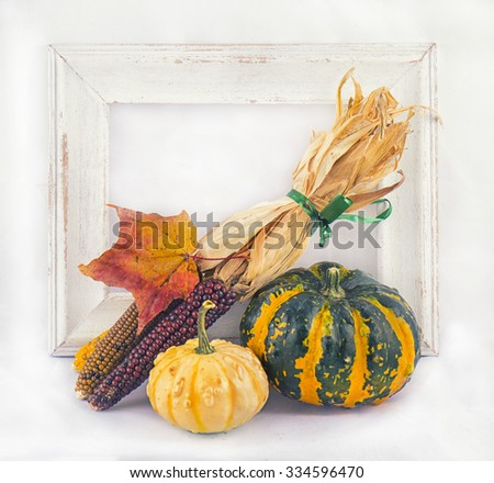 Abstract autumn background with pumpkins and fall leaves over white frame - stock photo