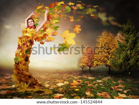 Abstract autumn image. Lady Autumn with leaves wings - stock photo
