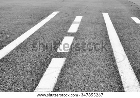 abstract background - asphalt road with road marking close up