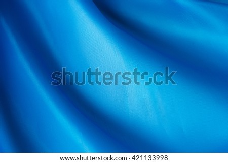 abstract background blue cloth with folds - stock photo