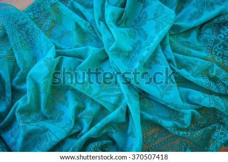 abstract background blue shaggy texture, textile scarf ornate material photo