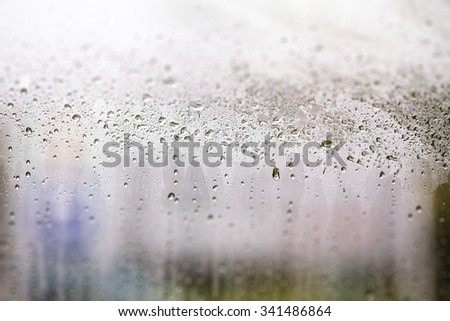 Abstract background. Blur Rain drops on the window.  - stock photo