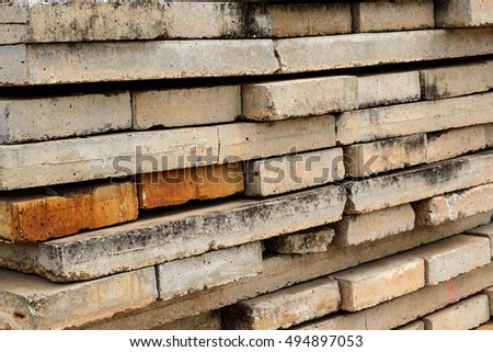 Abstract background Concrete blocks lined up in a mess.