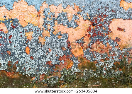 Abstract background concrete painted yellow, red, purple, blue paint, weathered with cracks and scratches. Landscape style. Grungy Concrete Surface. Great background or texture. - stock photo