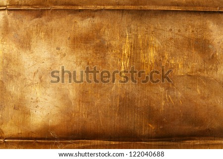 Abstract background from bronze sheet metal - stock photo