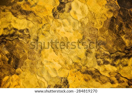 Abstract background from frosted glass texture (Gold Yellow) - stock photo