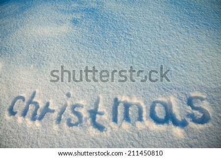 abstract background from inscription Christmas on snow - stock photo