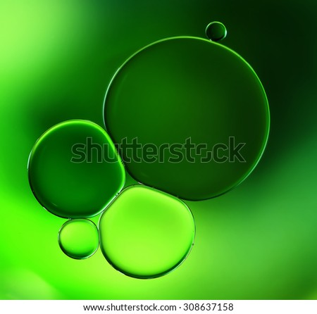 Abstract background, green oil droplets on water surface. Beautiful macro abstraction - stock photo
