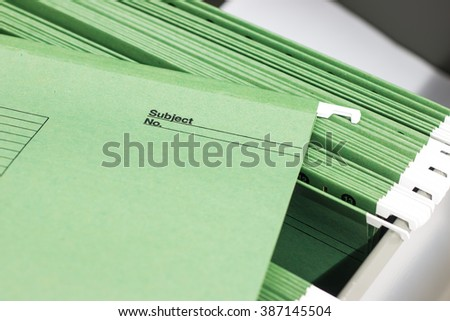 Abstract background image of file folders with personal finance documents. Conceptual strategy, vision or education.. Macro with with extremely shallow dof. Selective focus in front edges of files.