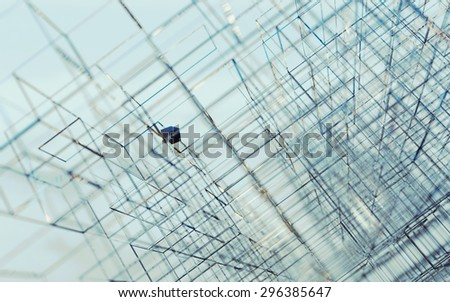 Abstract background image with small black cube detail.