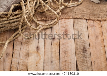 Abstract background in vintage style with burlap sack and rope