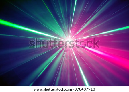 Abstract background. Light burst from laser at the party