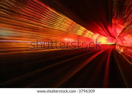 abstract background light waves in deep underground tunnel turning right - stock photo