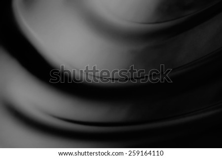 abstract background luxury cloth or liquid wave or wavy folds of grunge black silk texture satin velvet material or luxurious - stock photo