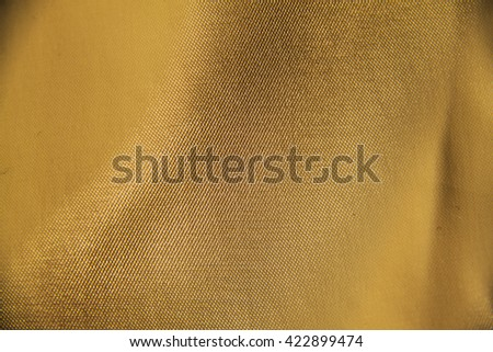 abstract background luxury cloth or liquid wave or wavy folds of grunge gold silk texture satin velvet material or luxurious - stock photo