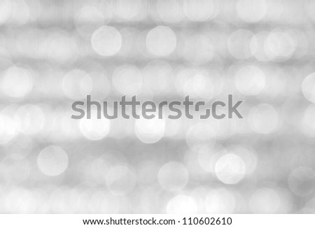 Abstract background of a blurry grey lights. - stock photo