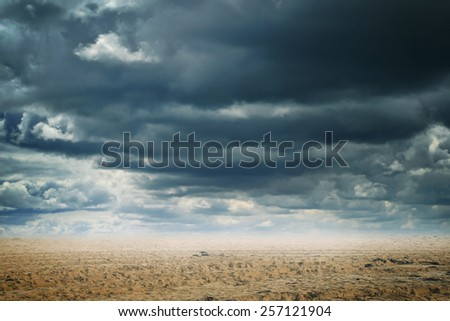 Abstract background of a sandy desert with dramatic cloudscape