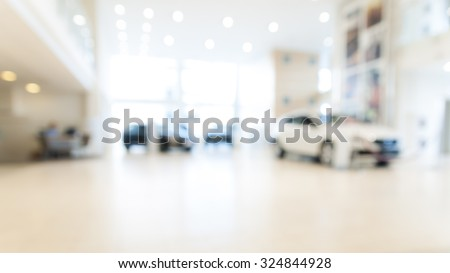 Abstract background of blurred  new cars dealership place - stock photo