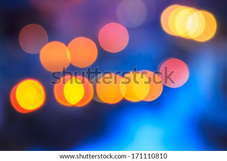 abstract background of blurred warm  lights with cool blue and purple background with bokeh effect - stock photo
