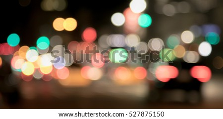 Abstract background of bokeh lights of city traffic in the evening, out of focus light painting.