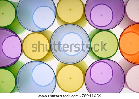 Abstract background of colored glasses of frosted plastic