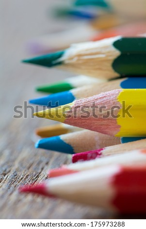 Abstract background of colorful pencils with extremely shallow dof.  - stock photo