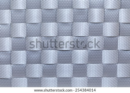abstract background of grey plastic woven texture - stock photo