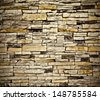 Abstract Background of Grungy textured dark effect red and yellow stone wall inside old neglected and deserted interior, masonry and carpentry brickwork concept - stock photo