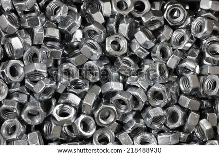 abstract background of lot ironwares screws closeup