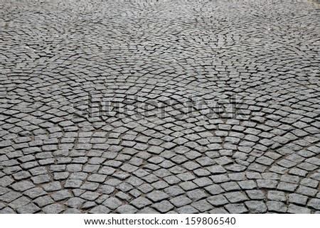 Abstract background of old cobblestone pavement. - stock photo