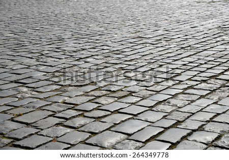 Abstract background of old cobblestone pavement close up. - stock photo