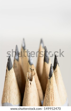 Abstract background of pencils with extremely shallow dof. Selective focus limited to broken pencil.  - stock photo