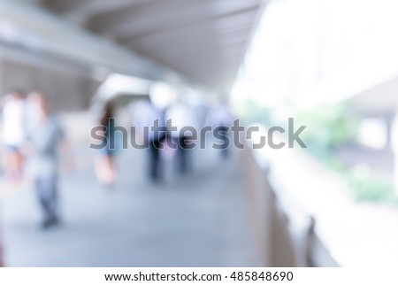Abstract background of people on footbridge