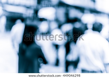 Abstract background of people on the street in blue tone