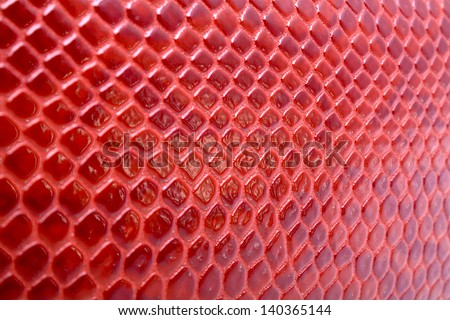 Abstract background of red snakeskin leather - stock photo