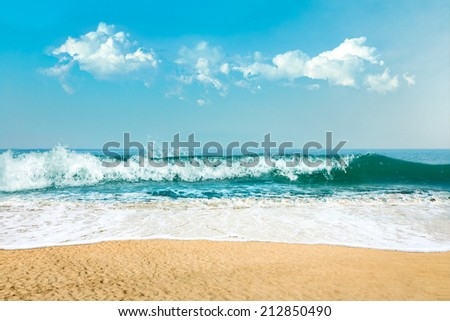 Abstract background of sea water and sand at tropical island - stock photo