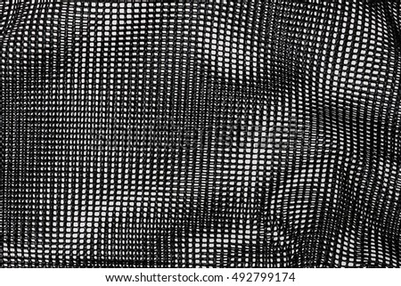 abstract background of seamless pattern of crossed lines from plastic net