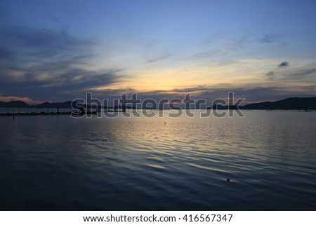 Abstract background of silhouette image sunset at lake in evening