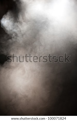 Abstract background of smokefilled air lit through the haze by overhead lights such as might be found at a live performance - stock photo