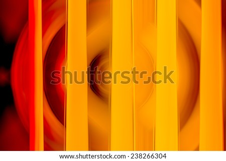 Abstract background of spin circle radial motion blur with stripes in black, red, orange, and yellow