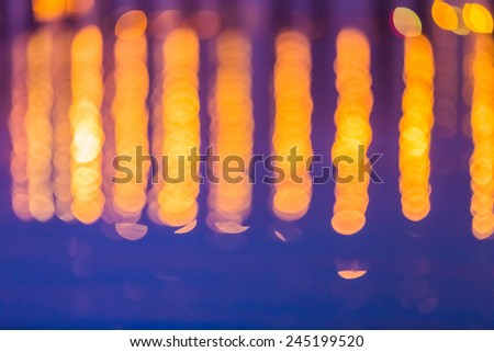 abstract background of the defocused traffic lights in the water. - stock photo
