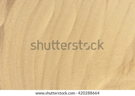 Abstract background of the golden brown sand
