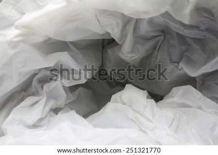 Abstract background of the insides of a white plastic bag with different color shades - stock photo