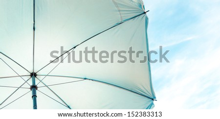 Abstract background of umbrella texture and clear sky with sparse clouds